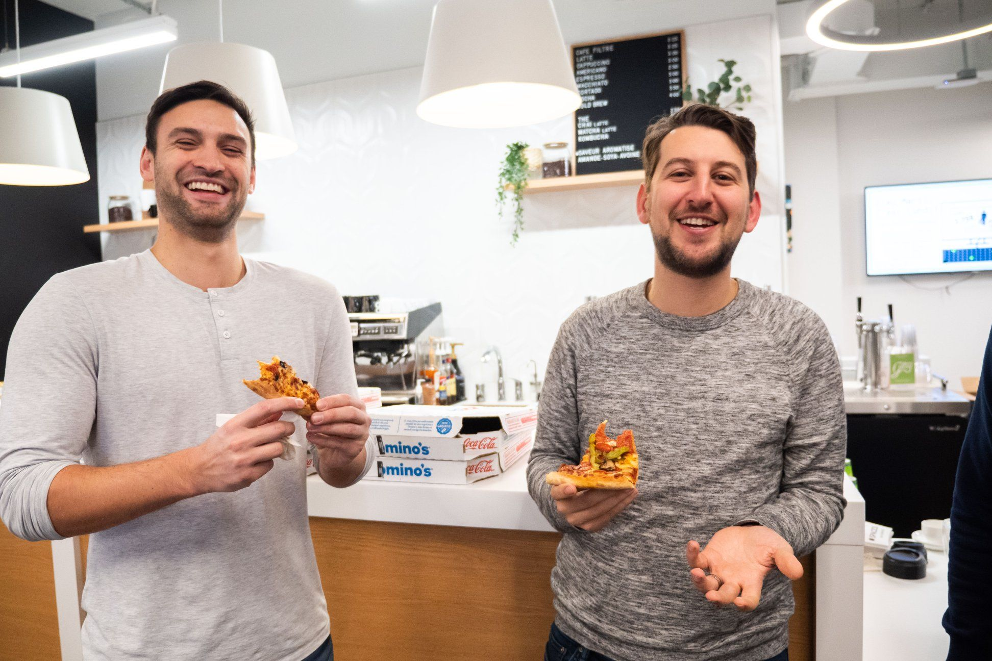 Me eating pizza with Lighthouse Labs' CEO Jeremy Shaki